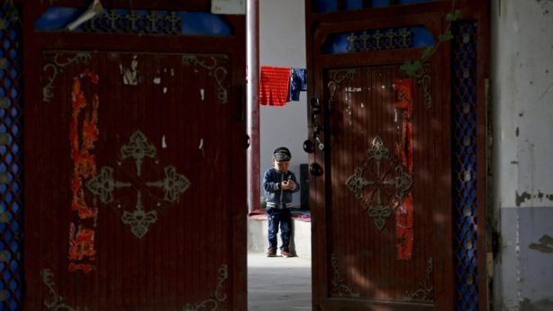 A-Uighur-child-in-a-courtyard-home-in-Hotan